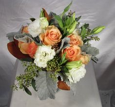 Bridal Show: peach roses, white lisianthus, with dusty miller and seeded euc.