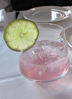 Sintorini cocktail made of Skinos (a Greek liquor), Red Passion Alize, lime juice, and soda. #cocktail #recipe