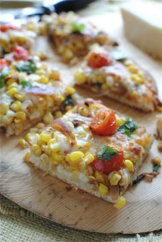 corn and tomato saute pizza with garlic, cilantro, lime, and mozzarella