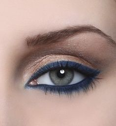 Navy liner with gold eye shadow