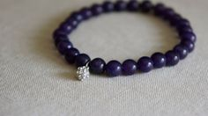 Purple jade beaded bracelet with pave charm.