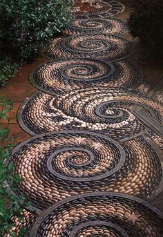 Swirl pebble mosaic path.