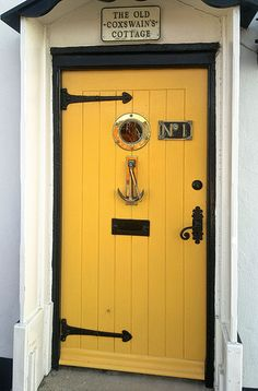 A quaint front door with a nautical theme on the Nothe Parade beside the Century Old Harbour at Weymouth, Dorset England. Door Knockers, Door Knobs, Door Handles, Casa Hipster, Yellow Doors, Nautical Home, Nautical Anchor, Nautical Interior, Vintage Nautical
