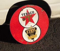 """Original texaco motor oil ethyl double sided porcelain sign. Nicknamed the """"8 ball sign"""" because the graphics look like an 8 on a pool ball. 30"""" diameter. Nice piece to give as a gift or just hang on a barn."""
