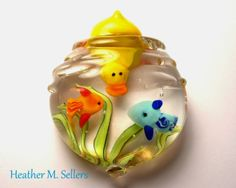 """Dive Team"" paperweight by Heather Sellers.  Flamework glass sculpture featuring a duck and fish in an underwater scene.  Soda-lime glass, Encasement, Cold Worked.  Enjoy!"