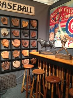 Love the mitt collection, would be great in a boy's room with granddads, dad's and the boys' mitts to begin and add to over the years! The bats on the bar would be a cool addition to a den, man cave, etc.