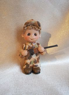 camouflage duck hunter hunting Christmas ornament camo polymer clay personalized gift. $18.95, via Etsy.