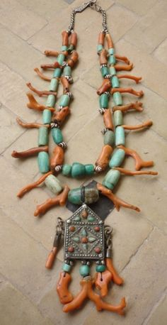 By Faouzi of Marrakech. | Necklace; Coral and amazonite beads combined with a silver prayer amulet