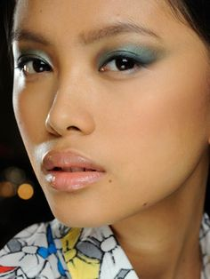 Apparently jewel toned eyeshadows were all the rage at #NYFW 2012.  I like the peacock green fade into gray/brown here.