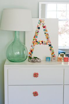 monogram buttons on canvas - cute for a kids room or craft area.for Alice's button collection