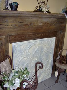 A simple painted tin cover may be the best and most affordable option to hide the unused gas fireplace. With the white painted mantle, it would lighten up the whole wall. Fireplace Cover Up, Unused Fireplace, Fake Fireplace, Victorian Fireplace, Fireplace Screens, Fireplace Inserts, Fireplace Mantels, Mantles, Wallpaper Fireplace