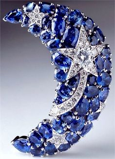 Chanel Joaillerie modelled as a crescent moon set with oval sapphires together weighing approximately 11.00 carats, highlighted by a shooting star set with brilliant-cut diamonds together weighing approximately 1.40 carats, mounted in 18 karat white gold, with retractable pendant fitting, signed and numbered 14J210.