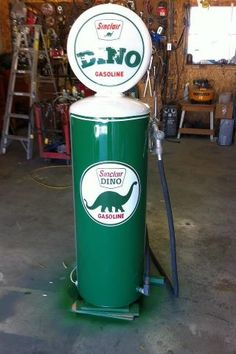 another vintage looking gas pump made out of a hot  water heater