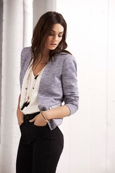 Go from uptown work day to downtown play date with this stunning blazer. It features a textured bouclé yarn, collarless neckline, faux zips and padded shoulder.