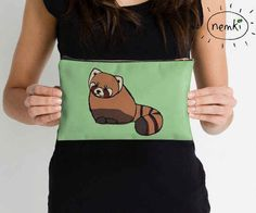 Keep your things in this adorable red panda clutch.