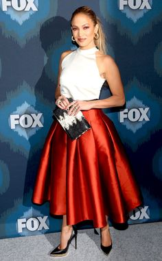 Jennifer Lopez from The Best of the Red Carpet JLo brings the heat to the Fox in All-Star party in a SisSae crop top paired with a molten copper Noir Sachin & Babi pleated skirt.