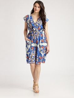 Print is really cute and placed in a flattering way.  Red or coral belt would be adorable.