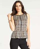 Animal Print Peplum Top - Accented with sleek contrast trim down the front and back, we love how this tawny animal print looks on a super-modern peplum silhouette. Jewel neck. Sleeveless. Peplum hem. Back keyhole with loop and button closure.