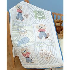 <li>Commemorate the birth of your special baby with this delightful crib quilt top <li>Needlework kit features a charming little boy design <li>Cross stitch kit makes just the right finishing touch to any nursery