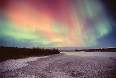 NASA aurora photos | This photograph shows a view of the aurorawith a red and a green ...