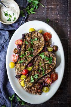 Crosshatched Zataar Roasted Eggplant served over rice or grains with lemony tahini sauce, plain yogurt or tzatzki sauce. Vegan, Gluten-free! | www.feastingathome.com