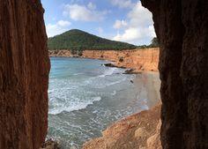 The cave of Sa Calleta overlooking the beach