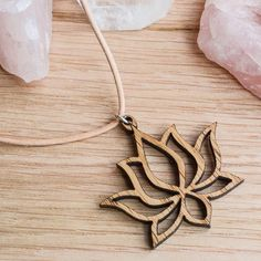 the_artists_design_studioLotus Blooming wood pendant on leather necklace - The Artists is an online design company, specializing in jewellery and 3D design, as well as the curation of beautiful design pieces and art. Visit our Facebook page www.facebook.com/theartists.co.za #theartistsdesign #theartistsstudio #theartistsjewellery #jewelry #designer #art #design #imagineersdesignerscreators #jewellery #natural #wood #geometry #spiritual