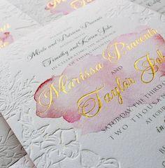 Blind letterpress and gold foil watercolor wedding invites.