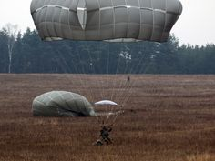 https://flic.kr/p/Qp7nJh | Prepare to land | U.S. Army Soldiers must be prepared to operate in any terrain, bringing the fight to those that threaten the safety of our nation or our allies.   Pictured: 82nd Airborne Division paratroopers prepare to land during an airborne operation at 7th Army Training Command's Grafenwoehr Training Area, Germany, during a U.S. Africa Command exercise, Dec. 9, 2016.  U.S. Army photo by Staff Sgt. Kathleen Polanco