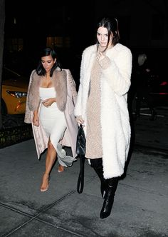 1230a54160b Walking tall  Kendall Jenner towered over sister Kim Kardashian while out to  dinner with Khloe in NYC on Tuesday evening