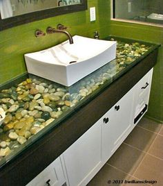 How gorgeous is this? I can imagine the whole bathroom now.relaxing forest green paint, river rock bed sink and mats, an old fashioned stand-alone white tub to match the sink. Would be awesome for a summer home! Ideas Baños, Board Ideas, Rock Bed, Deco Design, Beautiful Bathrooms, My Dream Home, Home Projects, Home Improvement, Sweet Home