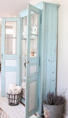 Gorgeous blue cabinet with french doors by nellie for girls bathroom