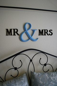 cute idea for above the bed. Would look even cuter with a spray painted funky photo frame around it!