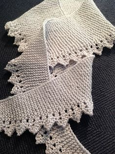 """Free on Ravelry, """"Zag Edged Scarf"""" by Laurel Brandt. This scarf is a simple lace edged, symmetrical and gradually sloped garter stitch triangle or trapezoid -- your choice of shape. Whether you make a triangle or trapezoid will depend on your desired width and length. You make this choice as you knit, so there is no need to swatch !!"""