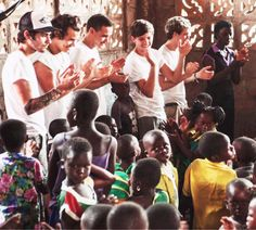 One Direction in Ghana! With a bunch of cute little kids not paying attention that don't give any fucks about them (;