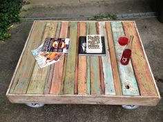 "Shabby-Chic Distressed Pallet Coffee Table with 8"" Steel Casters. $250.00, via Etsy."