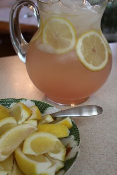 NGREDIENTS 1 (12 oz) can of frozen pink lemonade concentrate 1 (750 ml) bottle of chardonnay 1/2 c citrus vodka One bottle sparkling water One lemon (sliced into thin circles)