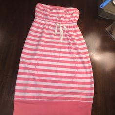 PINK tube top summer dress with front pocket Super cute, white and coral stripe PINK size XS tube top dress, excellent used condition, minor piling, but nothing wrong with it!! It's very comfy and perfect for the pool or a day at the mall! PINK Victoria's Secret Dresses Strapless