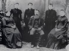 The Ingalls Family.  Seated from left: Ma (Caroline), Pa (Charles), Mary Standing from left: Carrie, Laura, Grace
