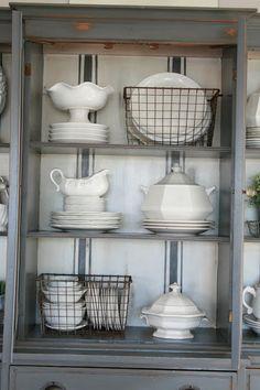 Grand Design: Grain sack stripe inspired hutch love the dishes in wire baskets Dish Display, China Cabinet Display, Hutch Display, How To Display China In A Hutch, Farmhouse China Cabinet, China Hutch Decor, Shelving Display, Hutch Cabinet, Cabinet Storage