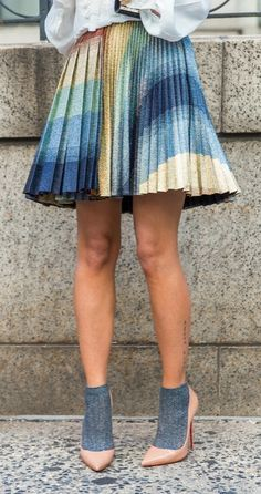 A pleated skirt and heels worn with socks