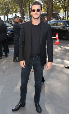 Try teaming a black sportcoat with black jeans to achieve a dressy but not too dressy look. Take a classic approach with the footwear and opt for a pair of black leather chelsea boots. Shop this look on Lookastic: https://lookastic.com/men/looks/black-blazer-black-crew-neck-t-shirt-black-jeans/21930 — Black Crew-neck T-shirt — Black Blazer — Black Jeans — Black Leather Chelsea Boots