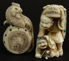 Lot of Two (2) Japanese Carved Ivory Netsukes. Both with Applied Enamel Decoration. Man & Child, One with Mythical Beast Cloak 1-3/4 Inches Tall; One a Chicken on a Drum. Both Signed With Character Marks. The Chicken with Minor Enamel Bead Loss or in Good Condition.