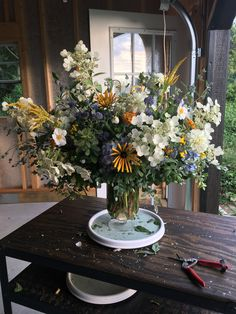A lush seasonal fresh floral design in blue, yellow, and white featuring hydrang… Summer Flowers, Fresh Flowers, White Flowers, Beautiful Flowers, Exotic Flowers, Yellow Roses, Purple Flowers, Pink Roses, Flower Arrangement Designs