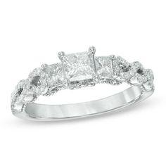 Love the twist shank on this pretty three-stone ring.