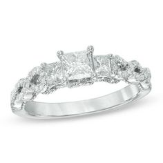 Love the twist shank on this pretty three-stone ring.