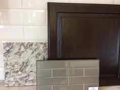 Dark walnut stained cabinets; Cambria quartz-Bellingham; Manhattan glass subway tile-Silk