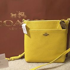 Summer Sunshine Yellow Coach Crossbody Bag NWT ***PRICE FIRM*** ***NO TRADES***Coach North/South Crossbody NWT, Embossed Textured Leather, Nearly Full Front Pocket & An Interior Slip Pocket, Matching Yellow Lining, Gold Tone Hardware, Long Adjustable Strap For Crossbody Wear Keeps Both Hands Free, Keeps Your Shoulders From Aching & Puts An End To Fumbling With Falling Down Shoulder Straps. I Bought This One At Coach; You Can Be Assured It's Authentic Coach Bags Crossbody Bags