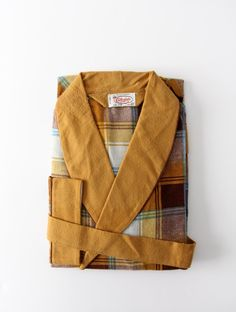 f419e8502 This is a vintage Collegiate children's robe. A brown, gold, blue, and  white plaid colors the flannel robe. cotton CONDITION In great condition.
