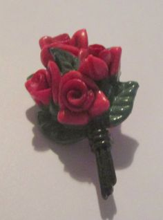 """vintage plastic brooch with red flowers made in Japan 1.50"""" in good condition"""